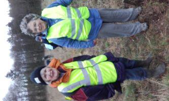 Members planting the oaks